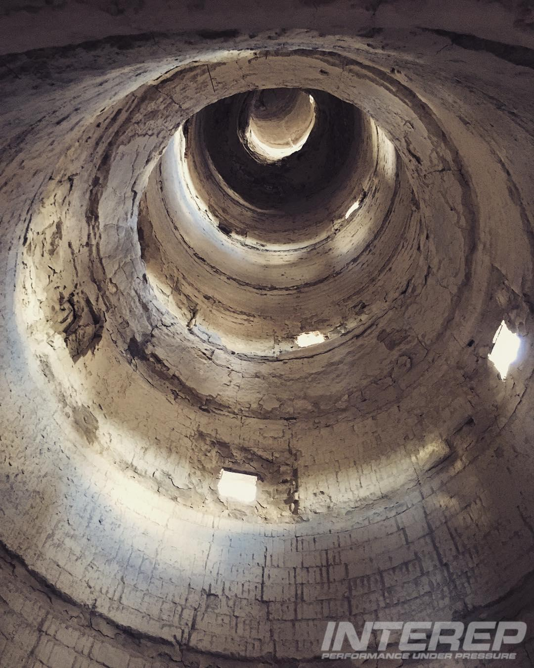 The inside of a pre-calciner (preheater) tower at a cement plant. In this system the hot combustion gasses from the kiln are passed up through the falling raw meal in a series of cyclones. The average preheater typically produces a hot feed that is 20% calcined when it enters the kiln, increasing the clinker output of the plant. Watch out for stainless steel that exhibits signs of chloride stress corrosion cracking on your preheater tower. Salts in the raw mix are often evaporated in the kiln and re-condense on cool points further upstream in the form of sodium chloride or potassium chloride.